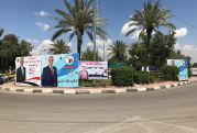 Campaign banners for various candidates line a street in Baghdad ahead of the upcoming election