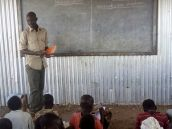Teacher Ochwor Onak Okwier, 37, teaches his students at Friends Primary school in Kakuma which hosts more than 8000 refugee students. Okwier received training from Teachers for Teachers, a group formed in 2016 by Columbia University Teachers College Professor of Practice Mary Mendenhall, the UN High Commissioner for Refugees, the Lutheran World Federation and Finn Church Aid. [PHOTO: Tonny Onyulo]